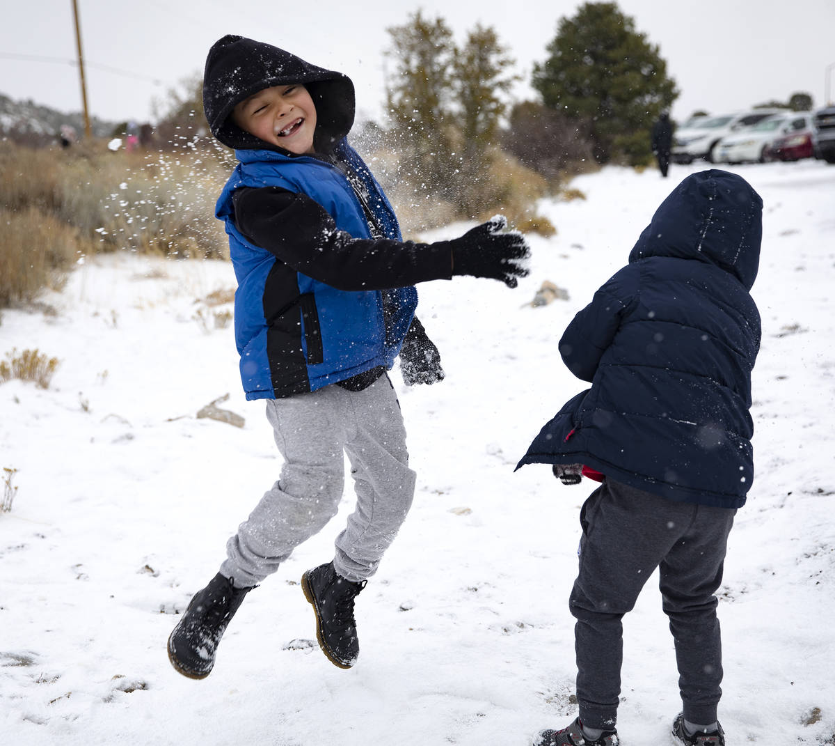Aaron Vasquez, 8, is hit with a snowball while playing with his brothers at Mt. Charleston, Sun ...