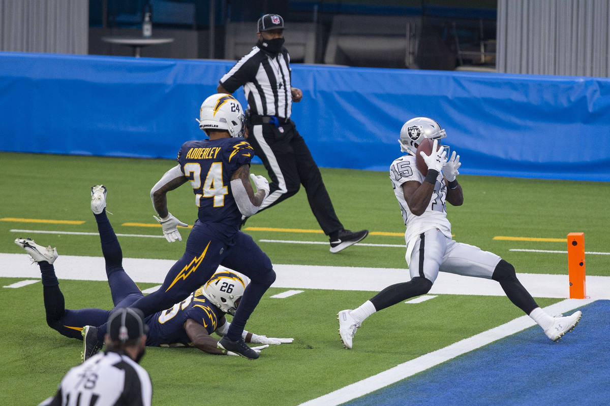 Las Vegas Raiders wide receiver Nelson Agholor (15) makes a catch and scores for a touchdown ov ...