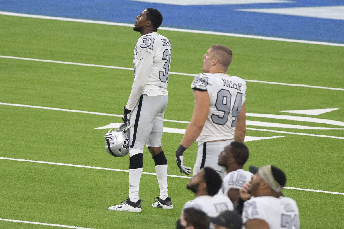 Las Vegas Raiders cornerback Isaiah Johnson (31) watches a replay of his stop of Los Angeles Ch ...