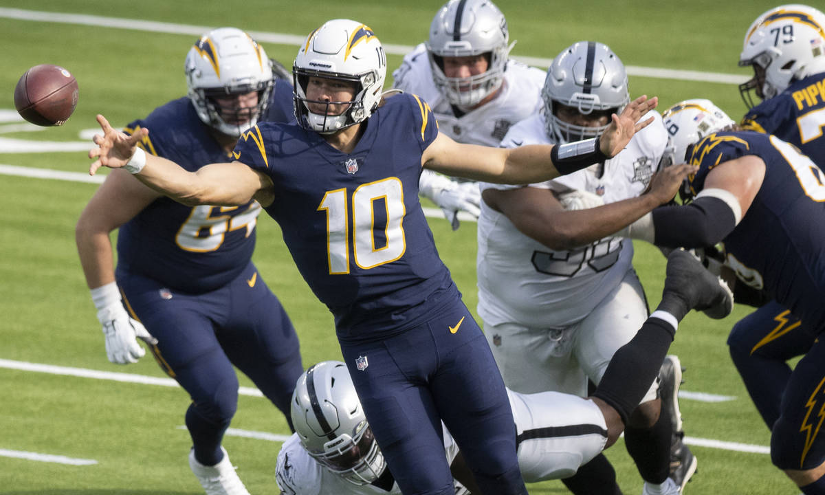Los Angeles Chargers quarterback Justin Herbert (10) throws a pass under pressure during the fi ...
