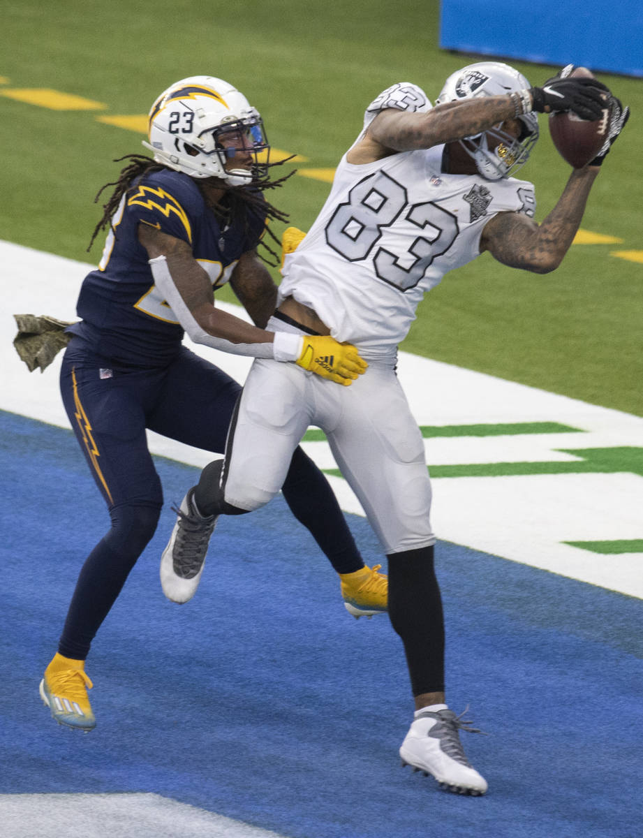 Las Vegas Raiders tight end Darren Waller (83) pulls in a touchdown pass over Los Angeles Charg ...