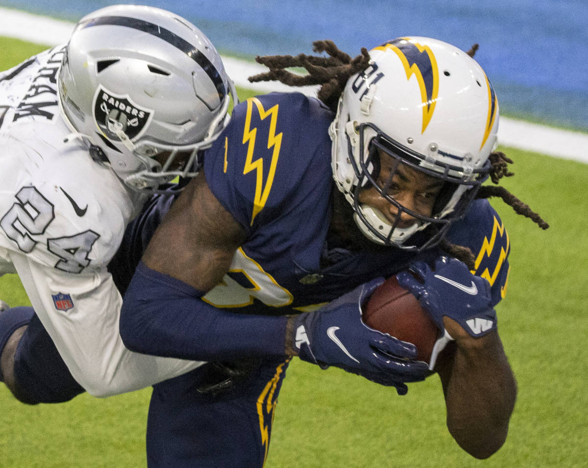 Los Angeles Chargers wide receiver Mike Williams (81) makes a catch over Las Vegas Raiders stro ...