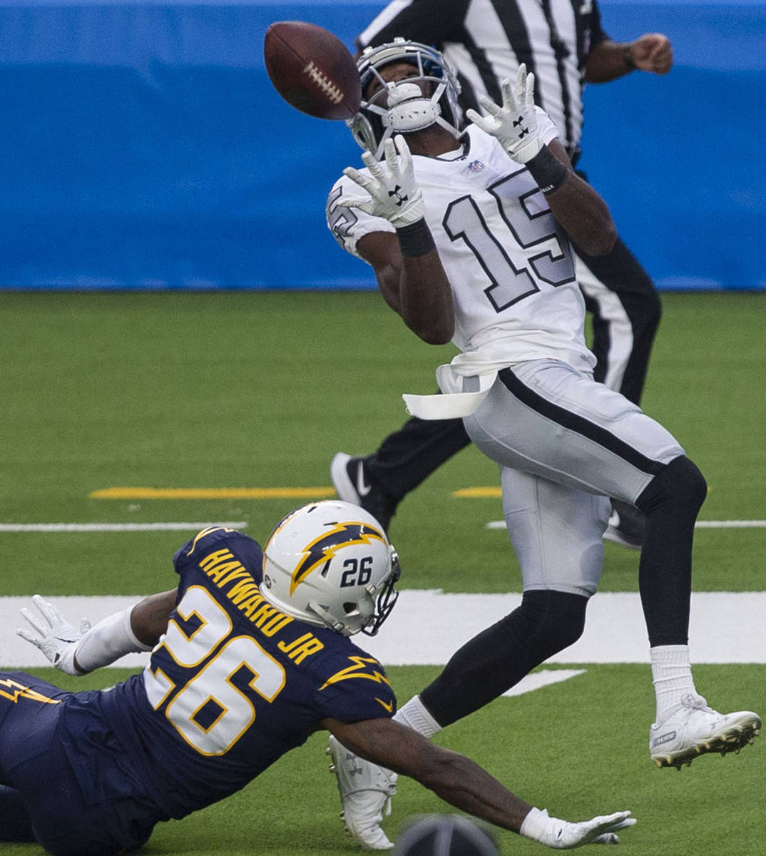Las Vegas Raiders wide receiver Nelson Agholor (15) prepares to make a catch over Los Angeles C ...