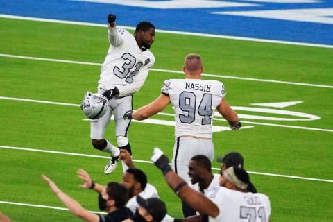 Las Vegas Raiders cornerback Isaiah Johnson (31) celebrates his stop of Los Angeles Chargers ti ...