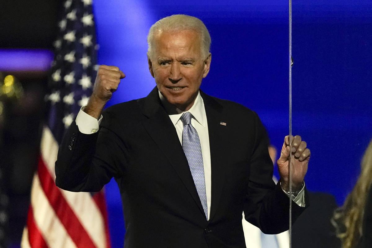President-elect Joe Biden gestures to supporters Saturday, Nov. 7, 2020, in Wilmington, Del. (A ...