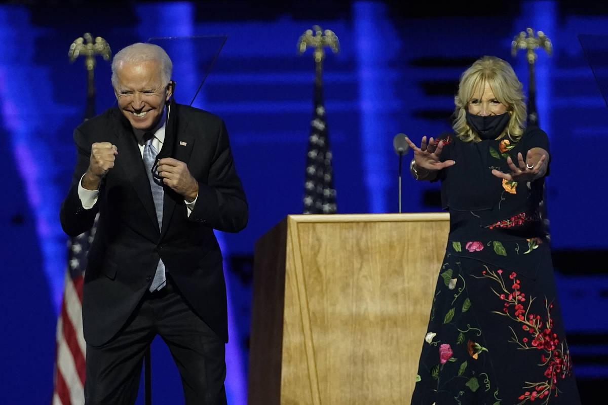 President-elect Joe Biden and wife Jill Biden gesture to supporters Saturday, Nov. 7, 2020, in ...