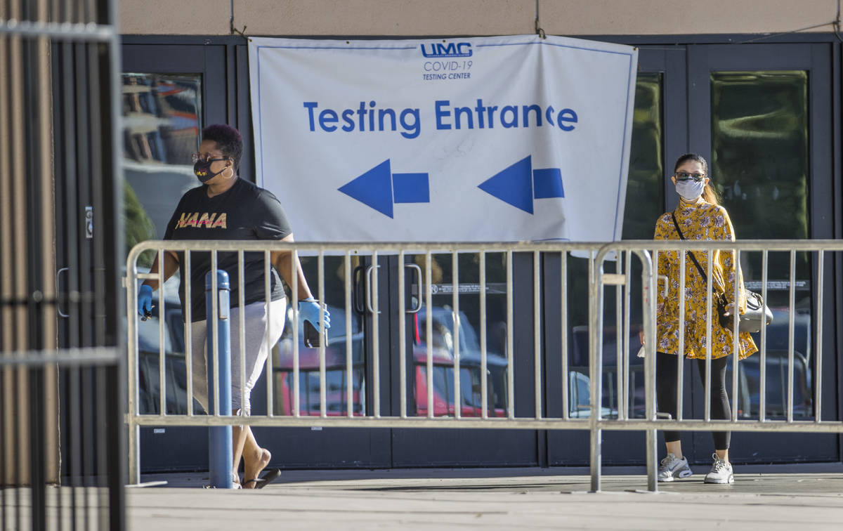 People enter the walk-up COVID-19 testing offered at Cashman Center in partnership with Univers ...