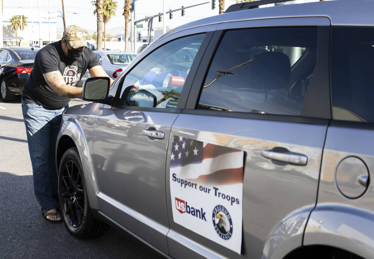 U.S. Army Staff Sgt. Deonty Eastmon takes a photo of his new car's VIN on Friday, Nov. 20, 2020 ...
