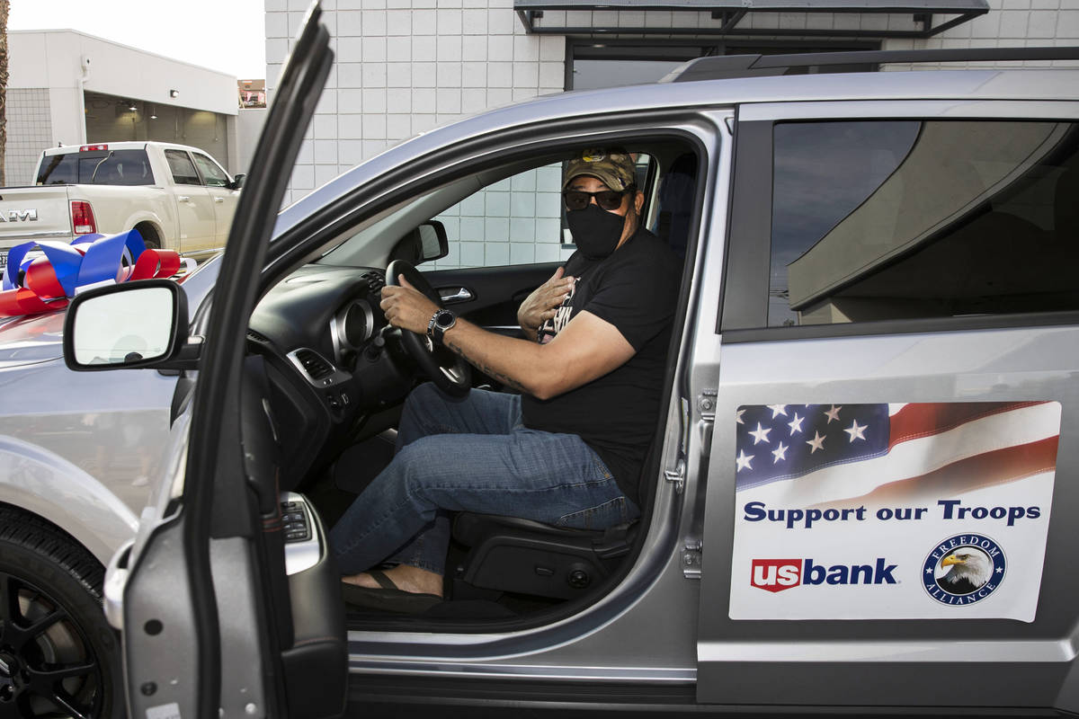 U.S. Army Staff Sgt. Deonty Eastmon checks out his 2018 Dodge Journey on Friday, Nov. 20, 2020, ...