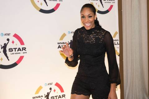Las Vegas Aces forward A'ja Wilson waves at fans on the WNBA Orange Carpet outside Della's Kitc ...