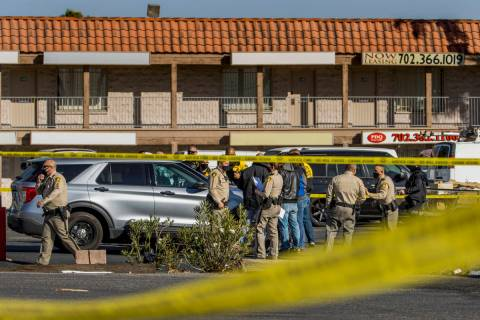 Las Vegas police meet as they investigate a homicide in the central valley near 3280 South Wynn ...