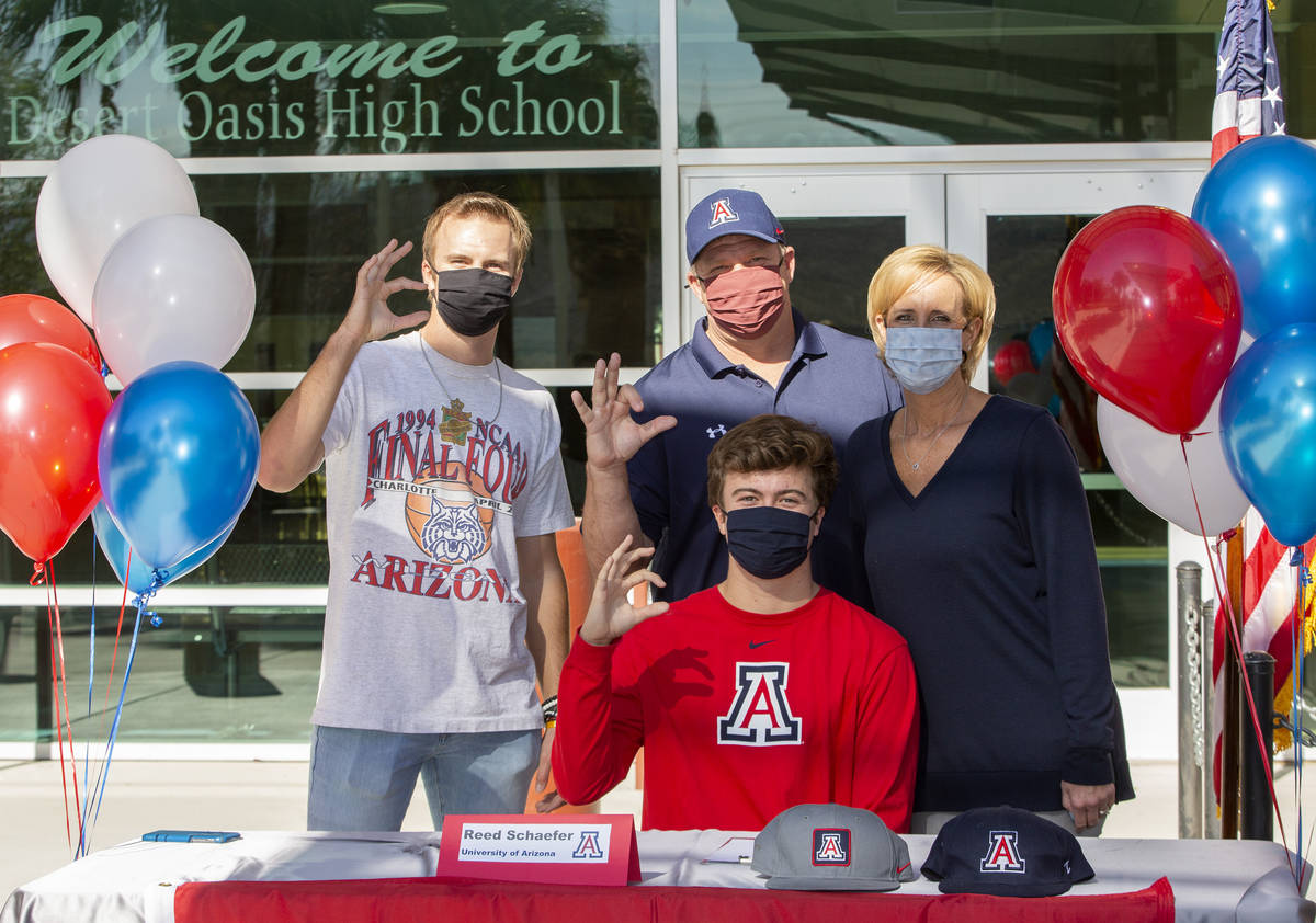 Reed Schaefer, who will play baseball at University of Arizona next year, poses for a photo wit ...