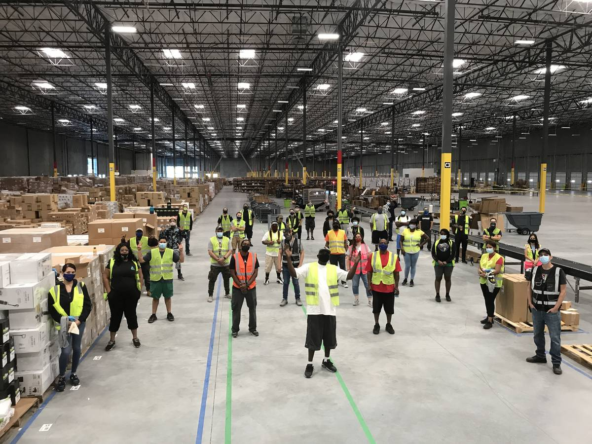Workers are photographed in Whitebox's newly leased industrial facility in North Las Vegas. (Cu ...