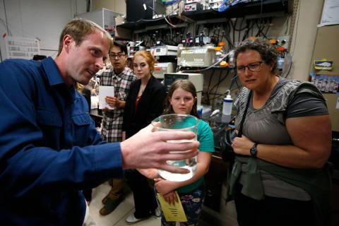 A Desert Research Institute researcher demonstrates an experiment. (Desert Research Institute)