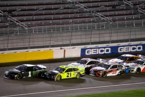 Drivers trail behind race winner Kurt Busch (1) duringa NASCAR Cup Series auto raceon Sunda ...