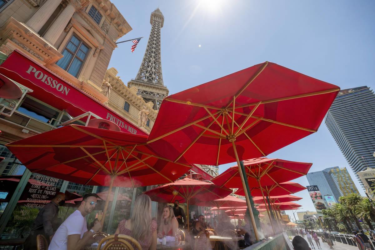 In this Aug. 7, 2020, file photo, guests dine at Mon Ami Gabi at Paris Las Vegas on the Strip. ...