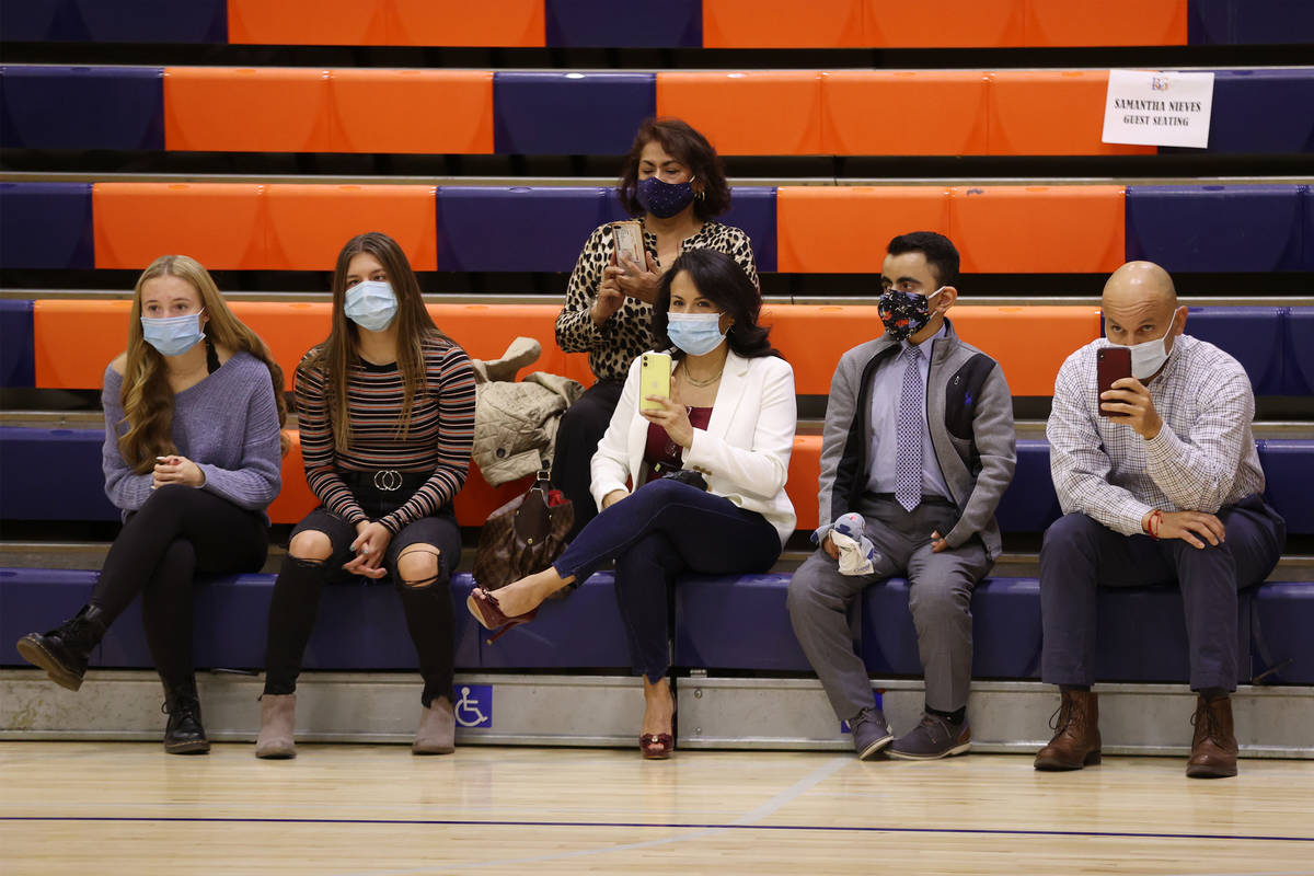 Family members attend a Signing Day ceremony at Bishop Gorman High School in Las Vegas, Thursda ...