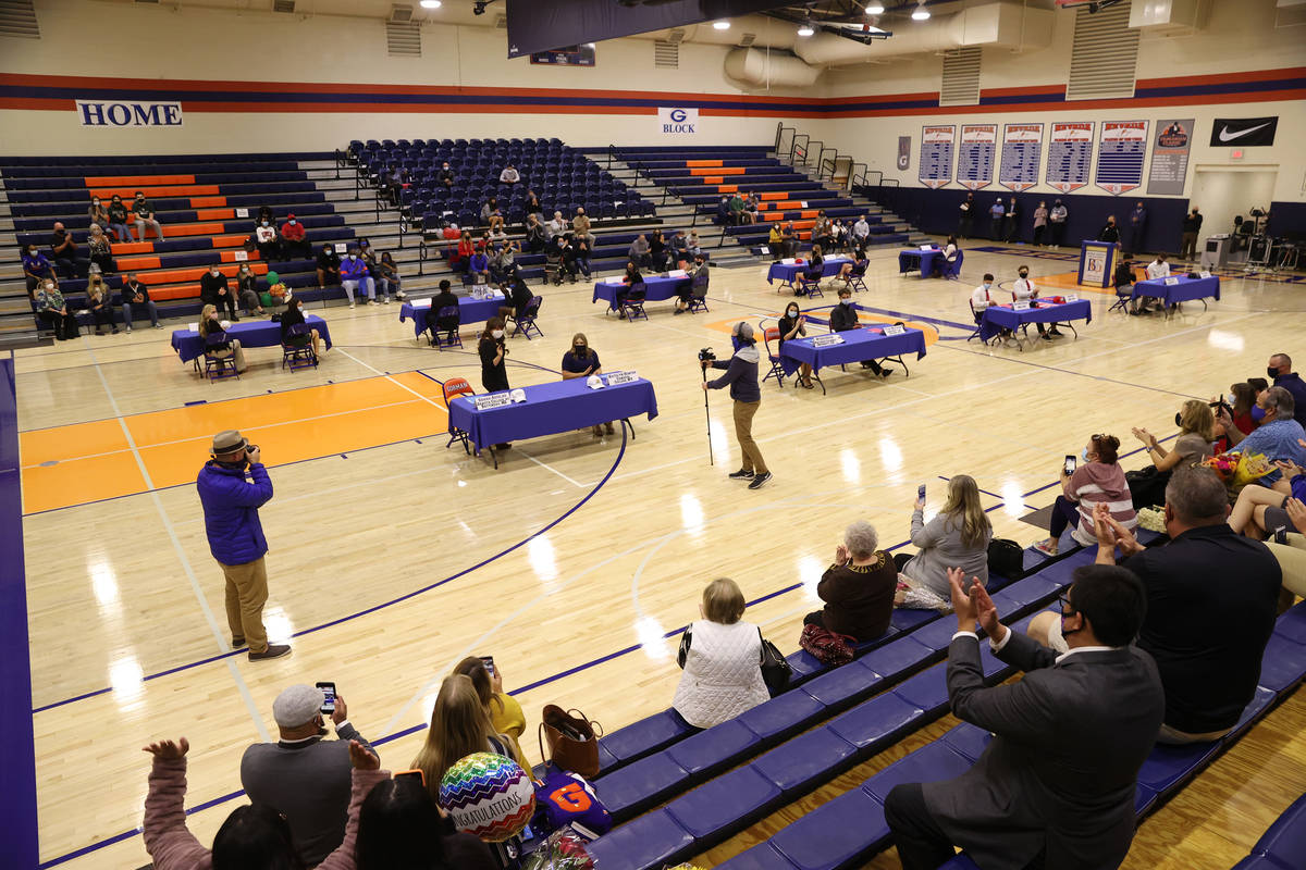Students and their families participate during a Signing Day ceremony at Bishop Gorman High Sch ...