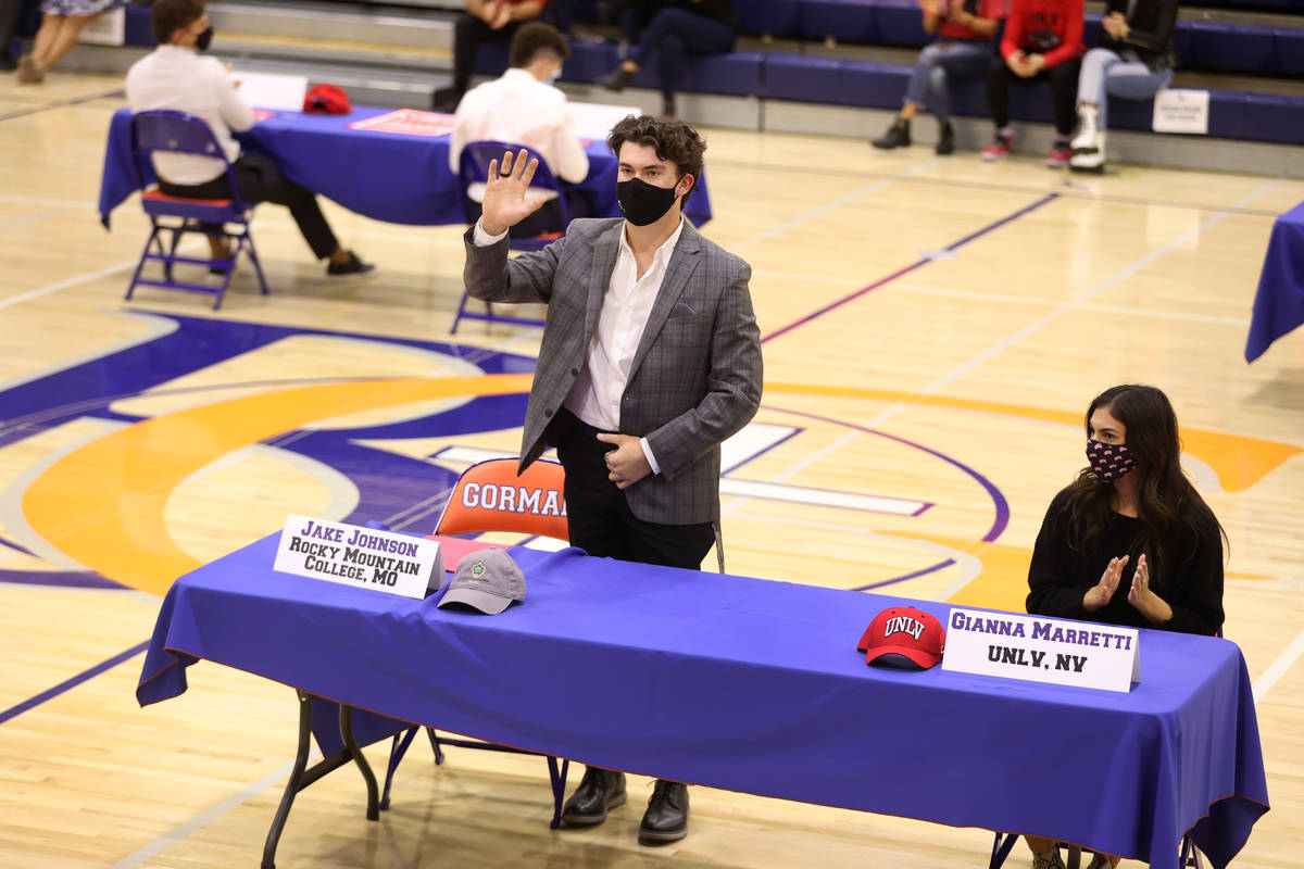 Jake Johnson, left, and Gianna Marretti participate during a Signing Day ceremony at Bishop Gor ...