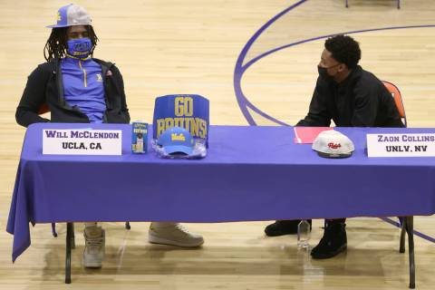 Will McClendon, left, and Zaon Collins, participate during a Signing Day ceremony at Bishop Gor ...