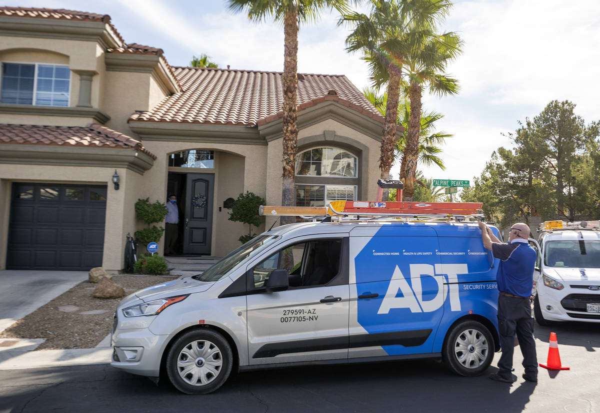 ADT Custom Home Services technician Paul Keplinger arrives at a home in Las Vegas on Nov. 5, 20 ...