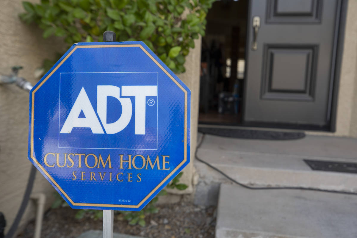 A sign advertising ADT Custom Home Services is seen during an installation of a security system ...