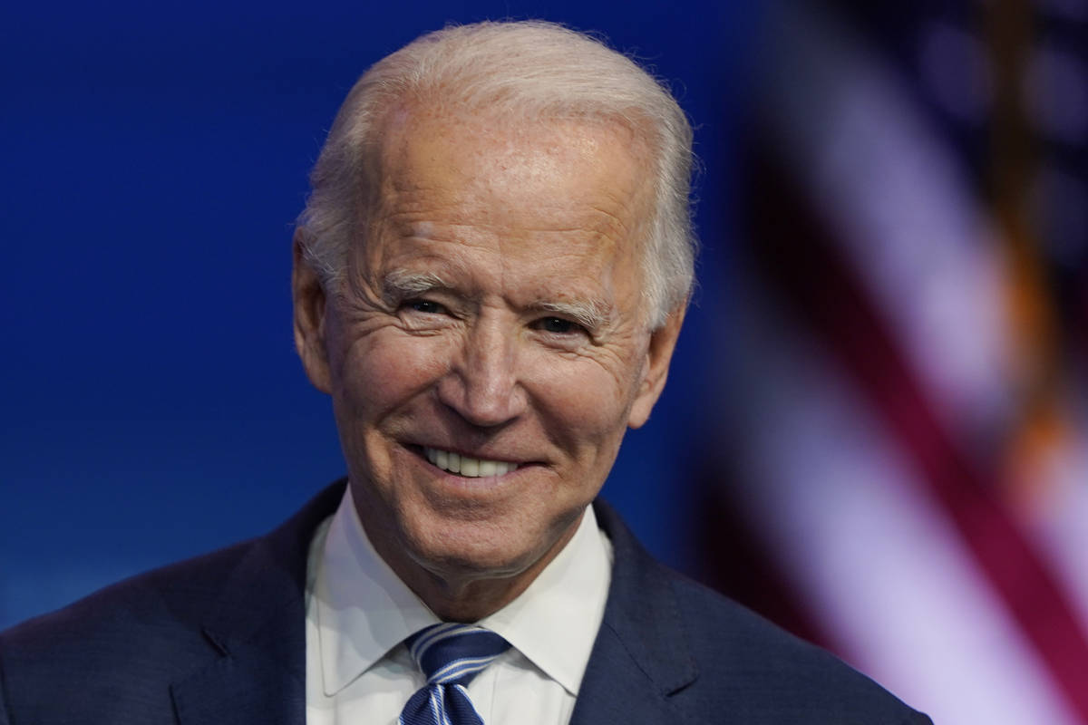 President-elect Joe Biden pauses as listens to media questions at The Queen theater, Tuesday, N ...