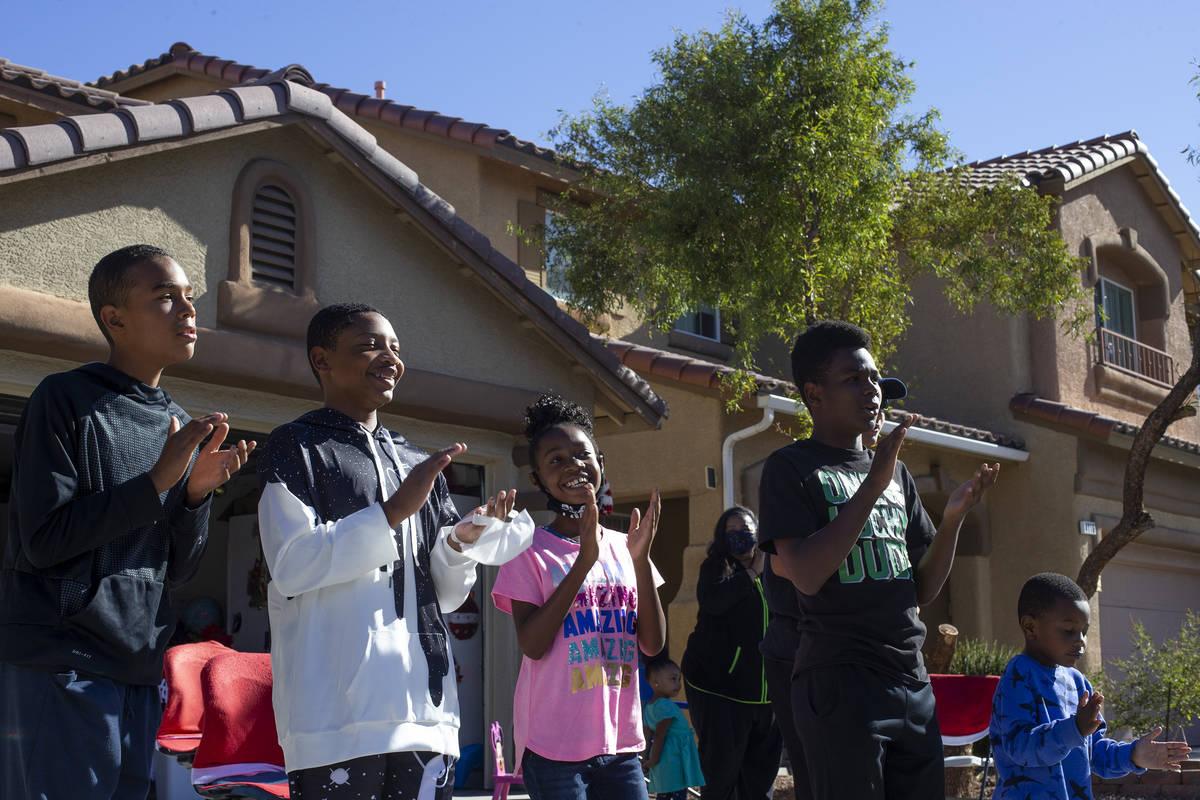 Members of the Burton-Watkins and Moffatt families, who live across the street from Las Vegan L ...