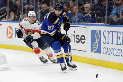 In this March 9, 2020, file photo, St. Louis Blues' Alex Pietrangelo (27) and Florida Panthers' ...