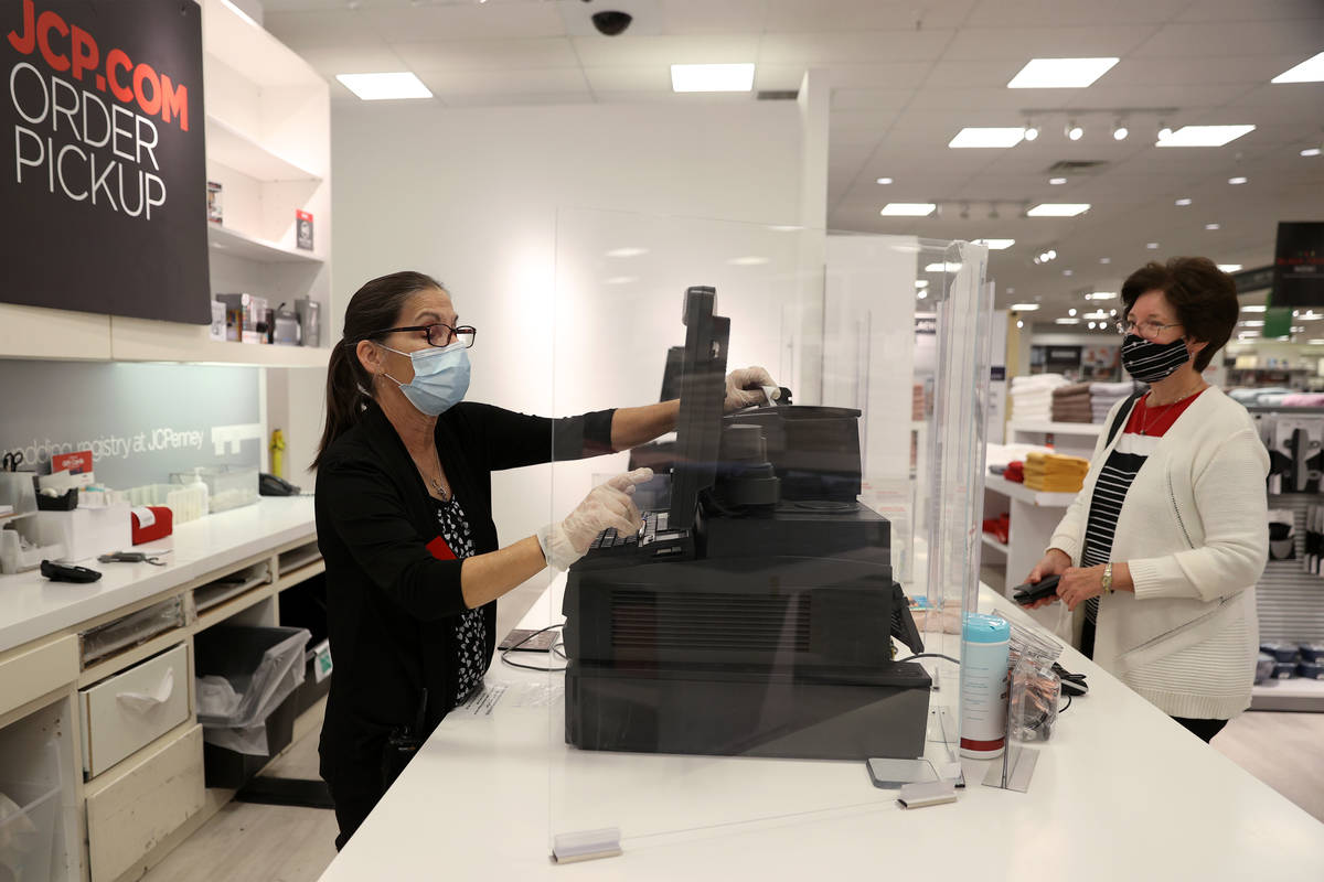 Customer service associate Gina Doxtater, left, retrieves an online order for pickup for Susan ...