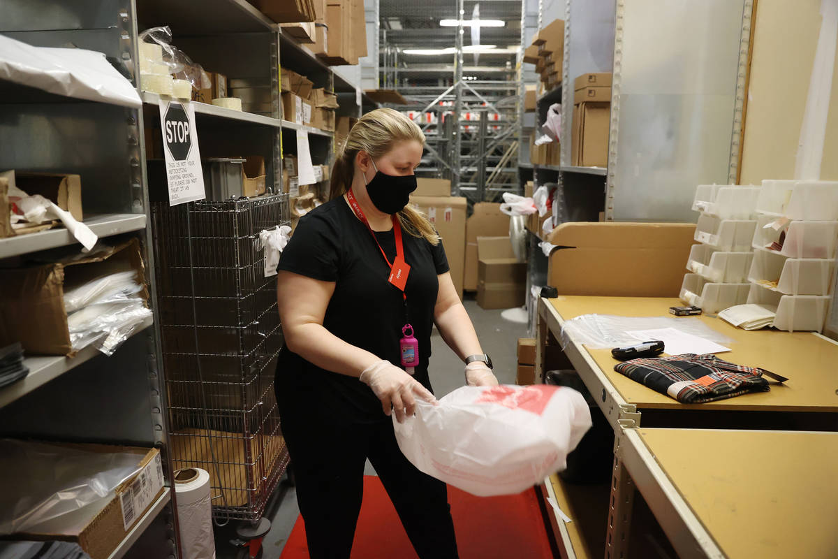 Customer service associate Alyssa Thompson fills an online order for store pickup at J. C. Penn ...