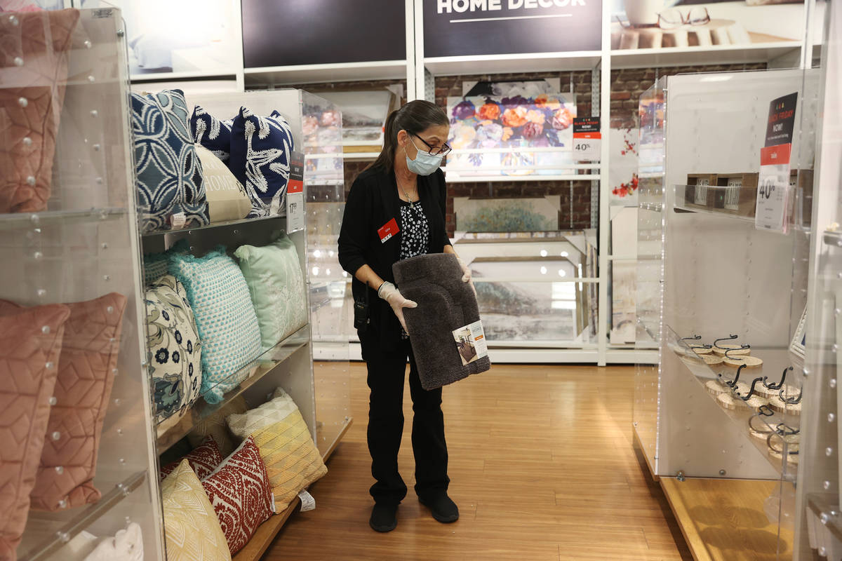 Customer service associate Gina Doxtater finds a space for a rug at J. C. Penney, 4485 S Grand ...