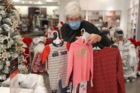 Carol Ratliff of Washington state shops for gifts at J. C. Penney, 4485 S Grand Canyon, in Las ...