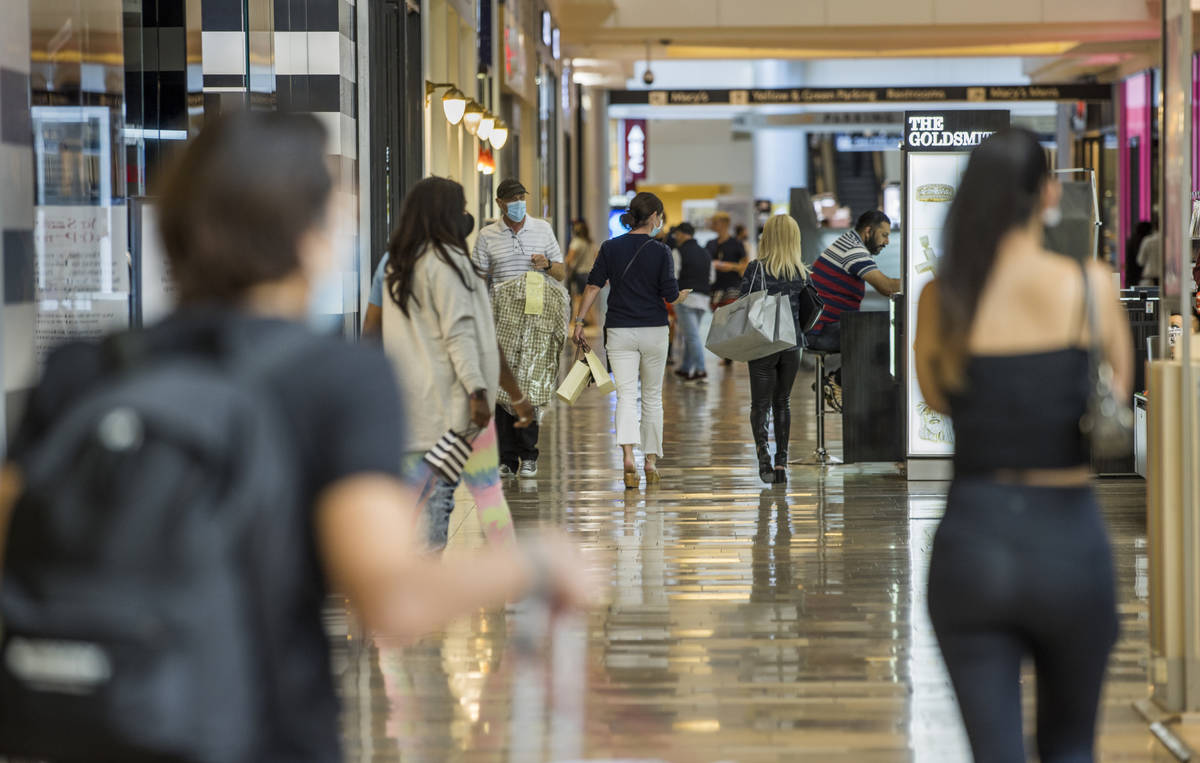 Shoppers make their way about the Fashion Show Mall on Thursday, Oct. 22, 2020, in Las Vegas. M ...