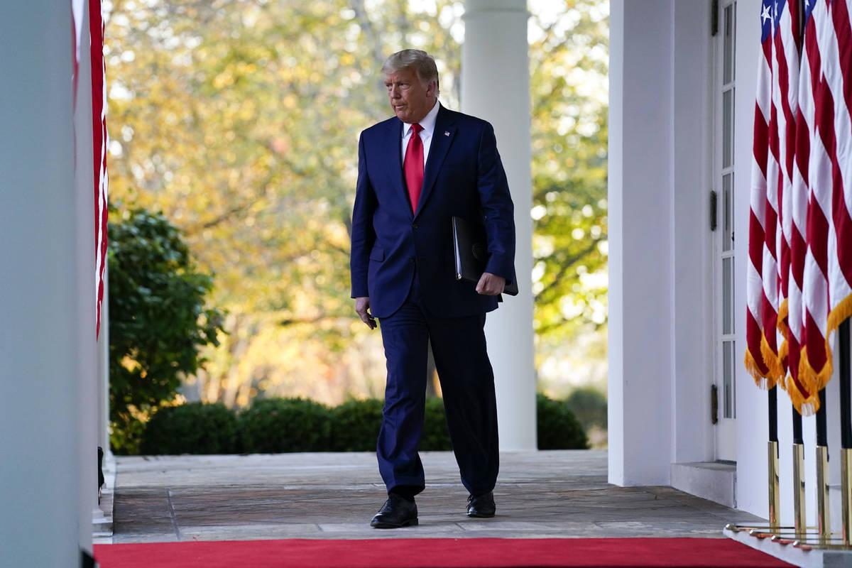 President Donald Trump arrives to speak in the Rose Garden of the White House, Friday, Nov. 13, ...