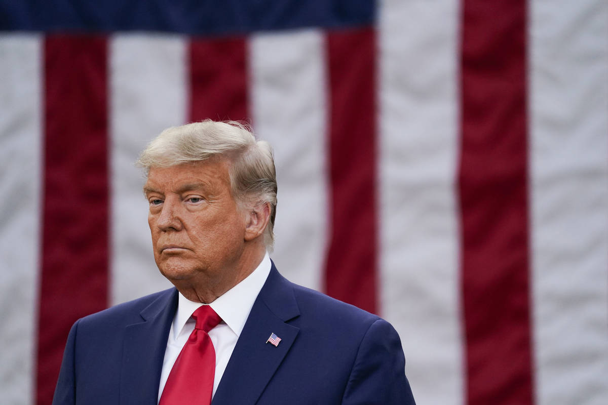 President Donald Trump listens during an event on Operation Warp Speed in the Rose Garden of th ...