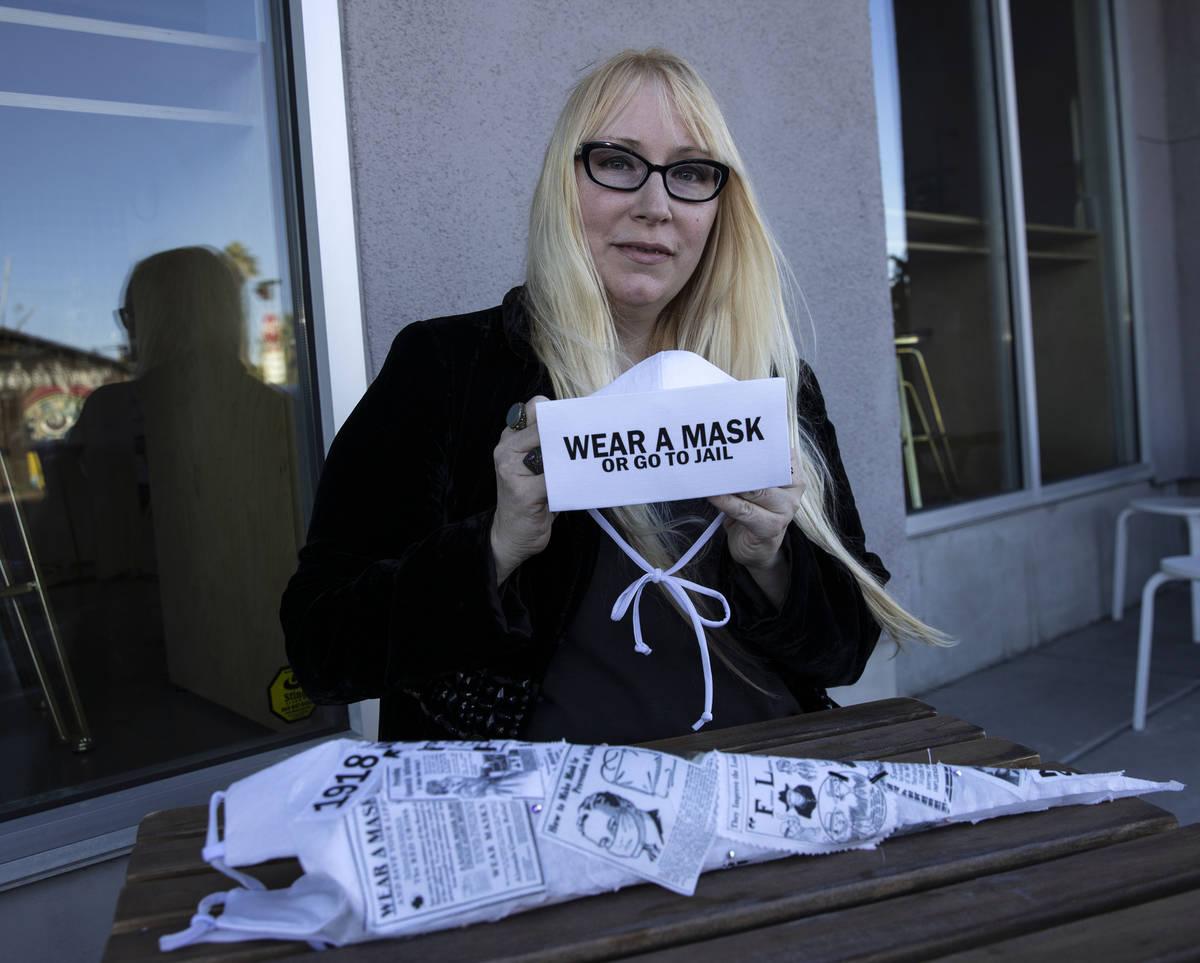 "A local fashion designer, Anna Bartoletti, displays her ""Wear a Mask or Go To Jail"" a ..."