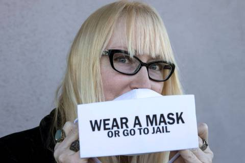 """A local fashion designer, Anna Bartoletti, shows off her """"Wear a Mask or Go to Jail"""" ..."""