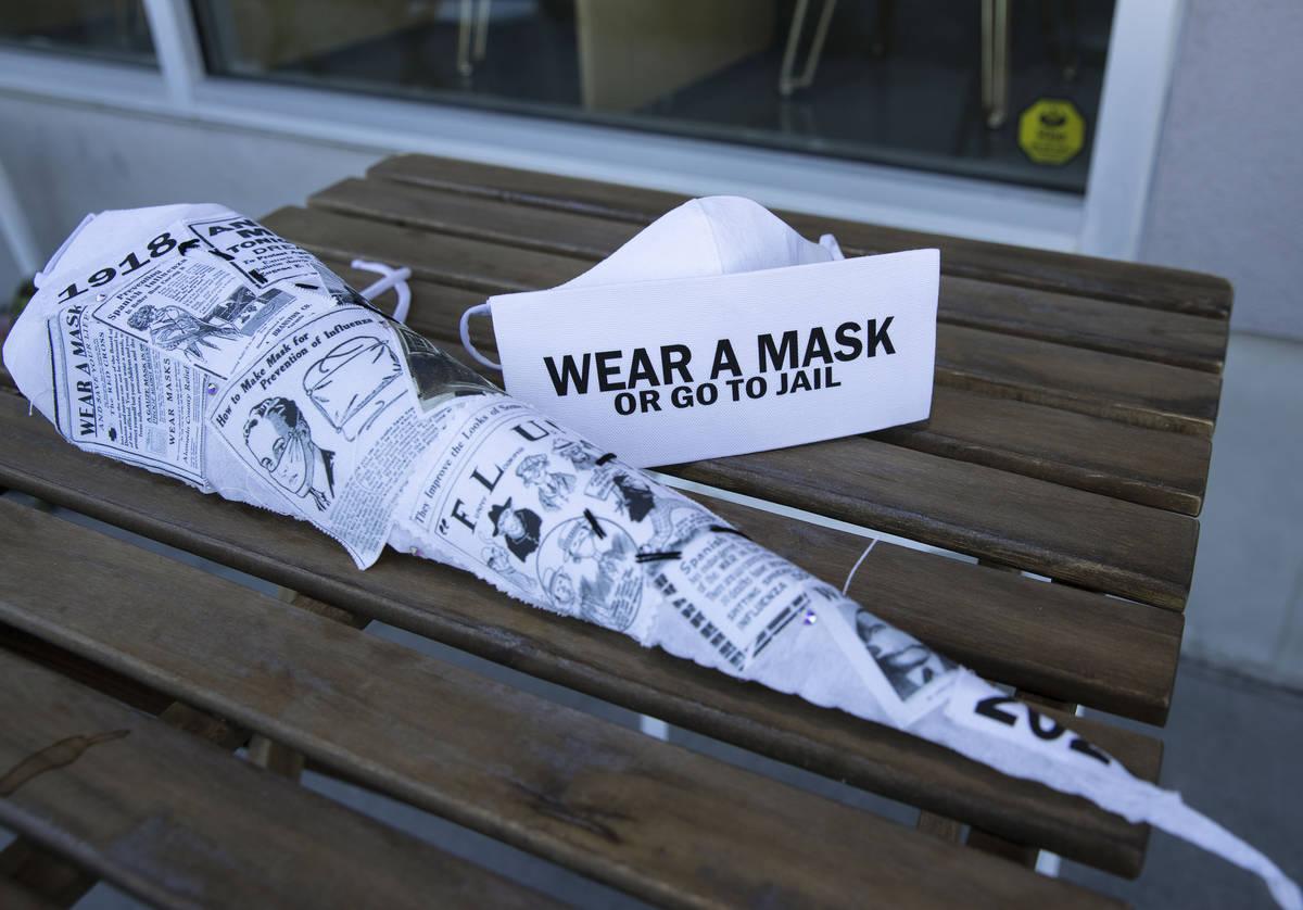 "Masks made by a local fashion designer, Anna Bartoletti, ""Full Circle, "" left, and ""Wear a Mas ..."