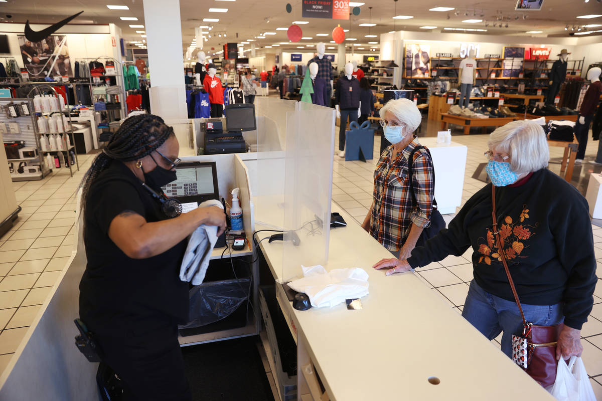 Supervisor Tamar Jackson, from left, checks out customers Carolyn Ratliff, and sister-in-law Ca ...
