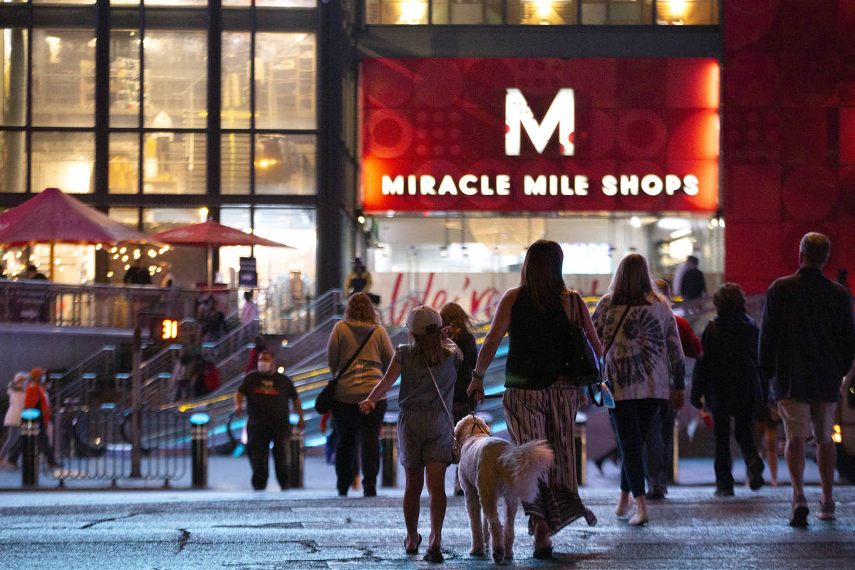 Visitors cross Las Vegas Boulevard toward Miracle Mile Shops on Monday, Nov. 16, 2020, on the L ...