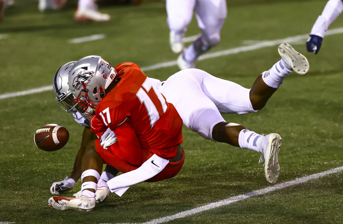 UNR Wolf Pack defensive back EJ Muhammad (4) breaks up a pass intended for New Mexico Lobos wid ...