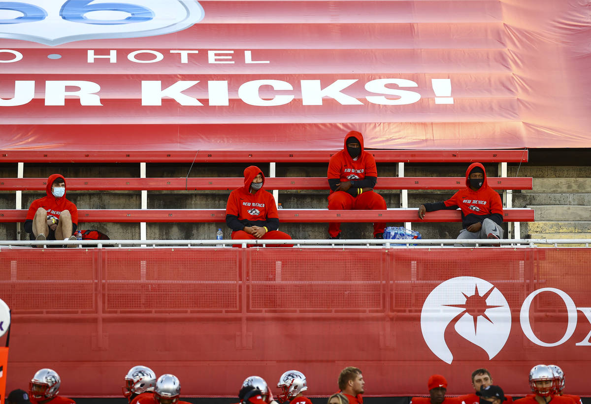 New Mexico Lobos players watch from the stands during the first half of a football game against ...