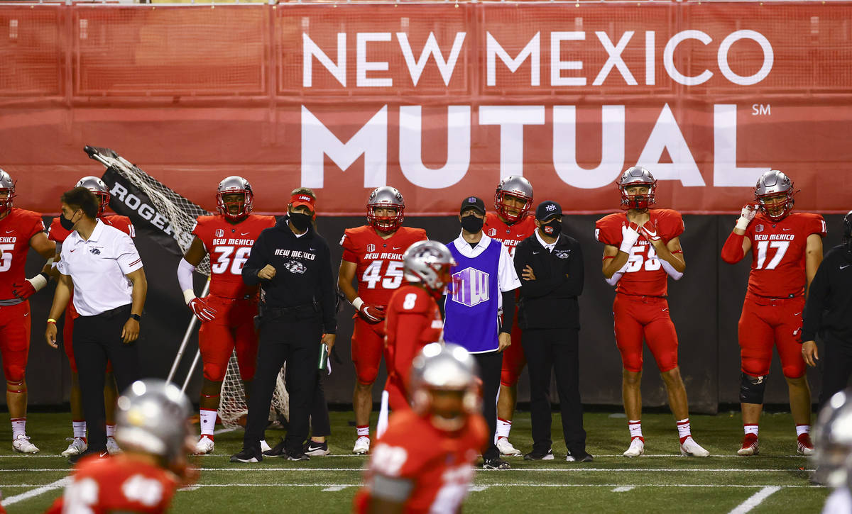 New Mexico Lobos players and staff look on as they play UNR during the second half of a footbal ...