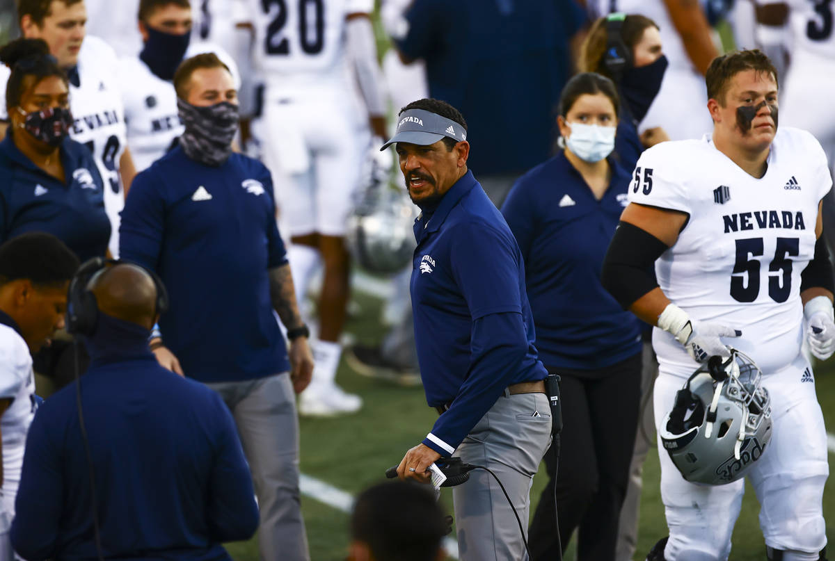 UNR Wolf Pack head coach Jay Norvell shouts toward a player during the first half of a football ...