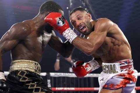 "Terence ""Bud"" Crawford, left, and Kell Brook exchange punches during their title fight Satu ..."