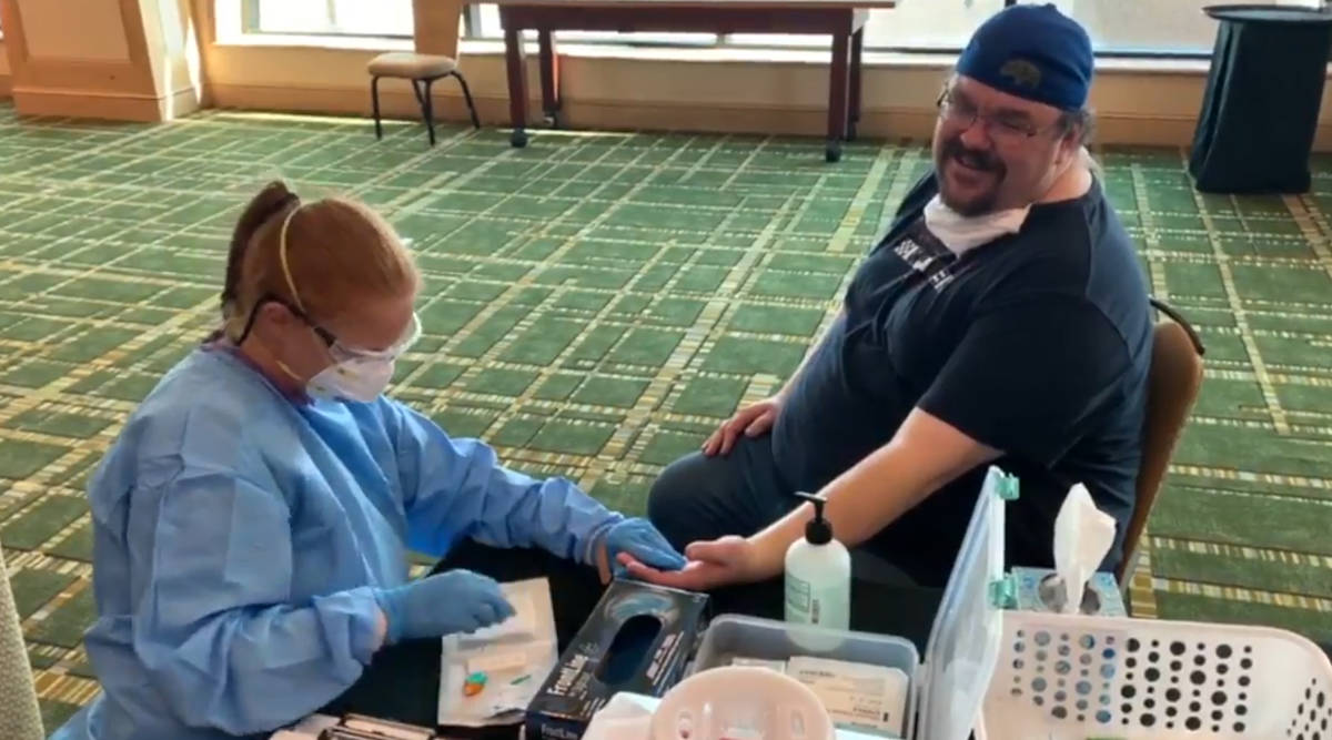 Adam Hill is tested for antibodies back in May at a UFC event in Jacksonville. (Las Vegas Revie ...