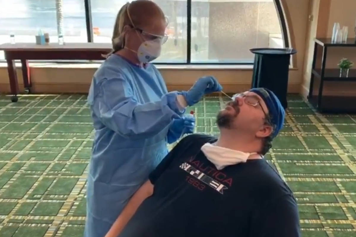 Adam Hill takes his first COVID test back in May at a UFC event in Jacksonville. (Las Vegas Rev ...