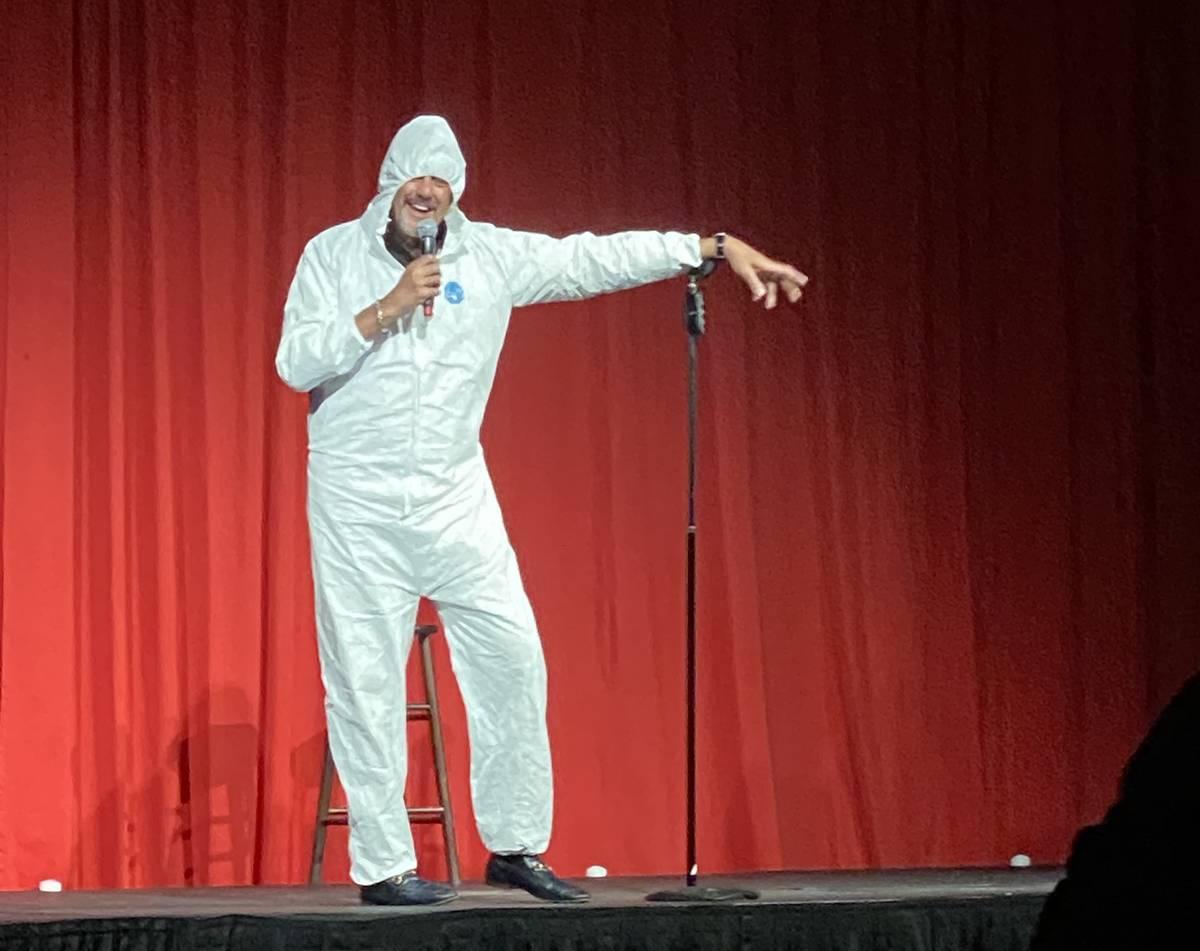 Brad Garrett is shown wearing his protective hazmat suit at the reopening of his Brad Garrett's ...
