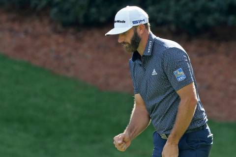 Dustin Johnson reacts after a birdie on the 13th hole during the final round of the Masters gol ...